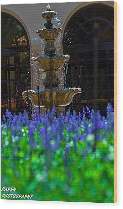 Blue Flowers And A Fountain Wood Print