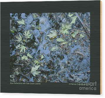 Blue Reflections With Pale Green Leaves Wood Print