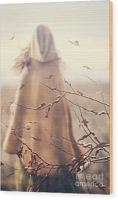 Wood Print featuring the photograph Blurred Image Of A Woman With Cape by Sandra Cunningham