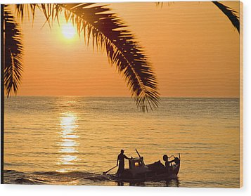 Boat At Sea Sunset Golden Color With Palm Wood Print by Raimond Klavins