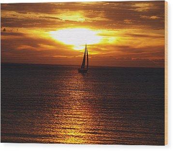 Boat At Sunset Wood Print by Susan Crossman Buscho
