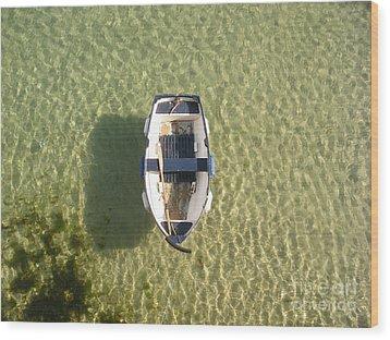 Boat On Ocean Wood Print by Pixel Chimp