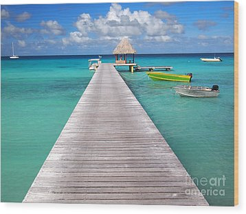 Boats At The Jetty In A Tropical Turquoise Lagoon Wood Print