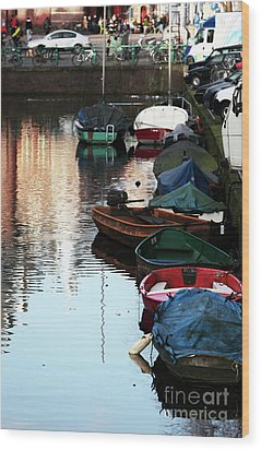 Boats In The Red Light District Wood Print by John Rizzuto