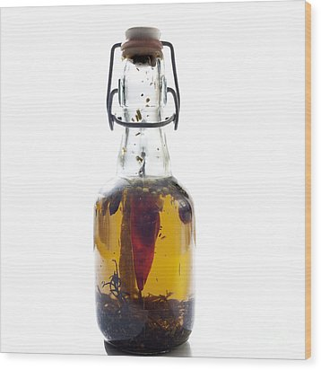 Bottle Of Oil Wood Print by Bernard Jaubert