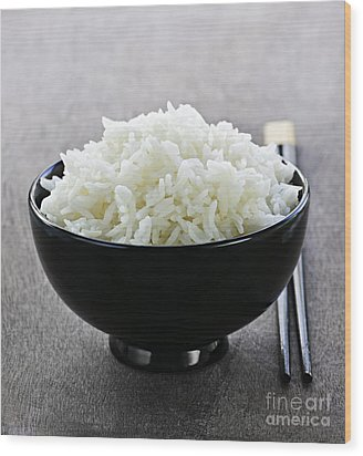 Bowl Of Rice With Chopsticks Wood Print by Elena Elisseeva