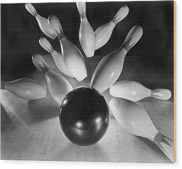 Bowling Ball Strikes Pins Wood Print by Underwood Archives