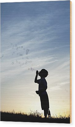 Boy Blowing Bubbles Wood Print by Tim Gainey
