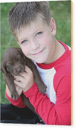 Boy Holding Puppy Wood Print by Colleen Cahill