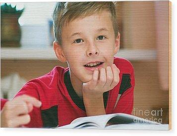Boy Reading Book Portrait Wood Print by Michal Bednarek