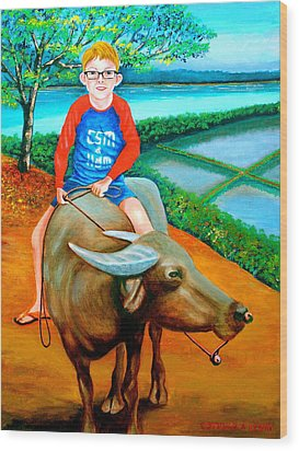 Boy Riding A Carabao Wood Print by Lorna Maza