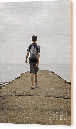 Boy Walking On Concrete Beach Pier Wood Print by Edward Fielding