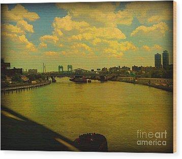 Bridge With Puffy Clouds Wood Print by Miriam Danar