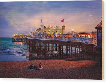 Wood Print featuring the photograph Brighton's Palace Pier At Dusk by Chris Lord