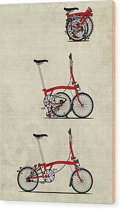 Brompton Bicycle Wood Print by Andy Scullion