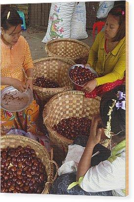 Wood Print featuring the photograph Burmese Ladies Sorting Water Chestnuts Zay Cho Street Market 29th Street Mandalay Burma by Ralph A  Ledergerber-Photography