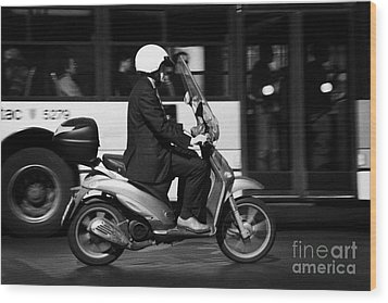 Business Man In Suit And White Helmet On Scooter Commutes Past Bus Full Of Passengers Through Piazza Wood Print by Joe Fox