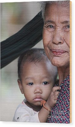 Wood Print featuring the photograph Cambodian Grandmother And Baby #3 by Nola Lee Kelsey