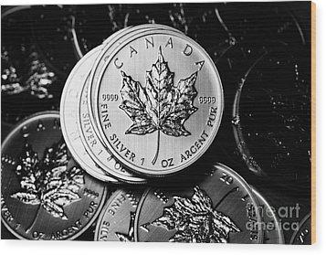 Canadian One Ounce Maple Leaf Silver Coins Wood Print by Joe Fox