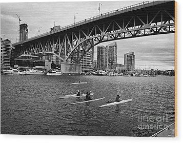 canoeists canoeing along false creek underneath the granville bridge Vancouver BC Canada Wood Print by Joe Fox