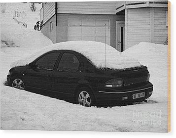 Car Buried In Snow Outside House In Honningsvag Norway Europe Wood Print by Joe Fox
