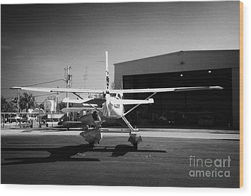 Cessna U206g Fixed Wing Single Engine Seaplane In Front Of Hangar Key West International Airport Flo Wood Print by Joe Fox