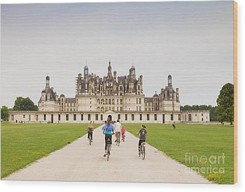 Chateau Chambord And Cyclists Wood Print by Colin and Linda McKie