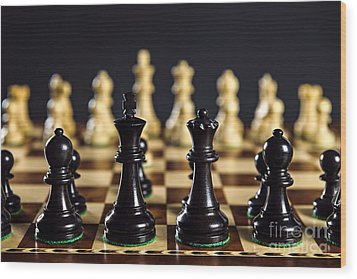 Chess Pieces On Board Wood Print by Elena Elisseeva