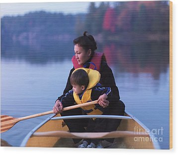 Child Learning To Paddle Canoe Wood Print by Oleksiy Maksymenko