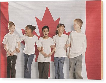 Children In Front Of Canadian Flag Wood Print by Don Hammond