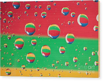 Clolrful Water Drop Reflections Wood Print by Sharon Dominick