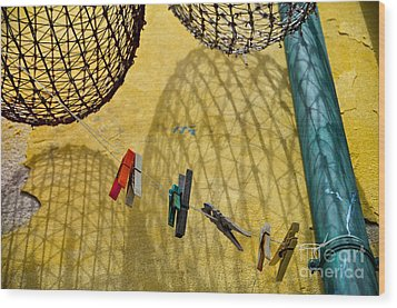Clothesline And Fish Traps Wood Print