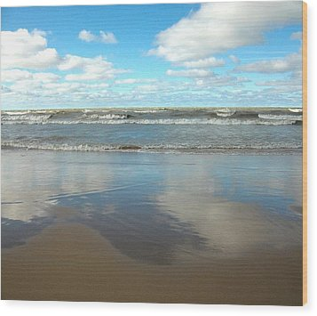 Clouds Reflecting Wood Print by Cim Paddock