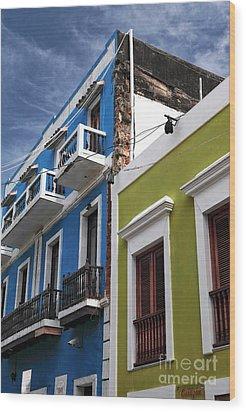 Colores Del Edificio Wood Print by John Rizzuto