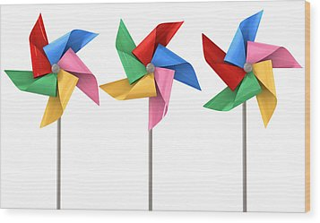 Colorful Pinwheels Isolated Wood Print by Allan Swart