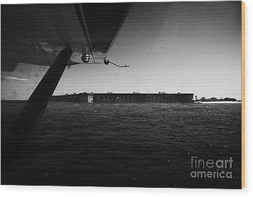Coming In To Land On The Water In A Seaplane Next To Fort Jefferson Garden Key Dry Tortugas Florida  Wood Print by Joe Fox