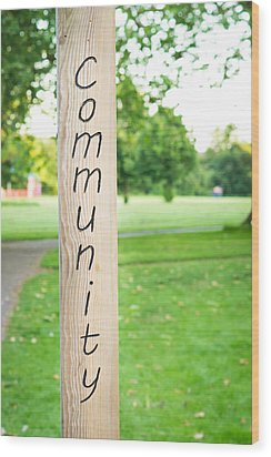 Community Sign Wood Print by Tom Gowanlock