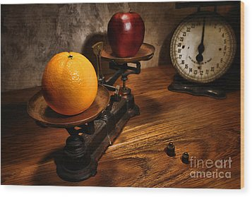 Comparing Apple And Orange Wood Print by Olivier Le Queinec