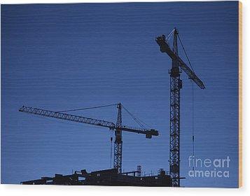Construction Cranes At Dusk Wood Print by Antony McAulay