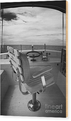 Controls On The Flybridge Deck Of A Charter Fishing Boat In The Gulf Of Mexico Wood Print by Joe Fox