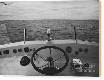 Controls On The Flybridge Deck Of A Charter Fishing Boat In The Gulf Of Mexico Out Wood Print by Joe Fox