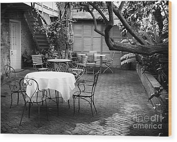 Courtyard Seating Wood Print by John Rizzuto