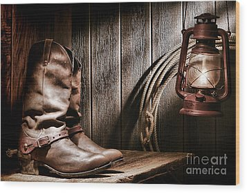 Cowboy Boots In Old Barn Wood Print by Olivier Le Queinec