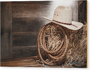 Cowboy Hat On Hay Bale Wood Print by Olivier Le Queinec
