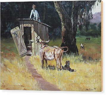 Cowboy On The Outhouse  Wood Print by Lee Piper