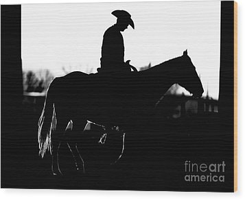 Wood Print featuring the photograph Cowboy Rides Home In Silhouette by Lincoln Rogers