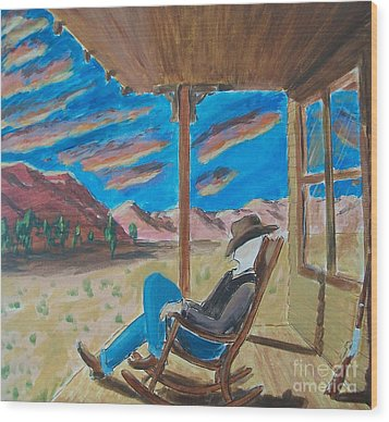 Cowboy Sitting In Chair At Sundown Wood Print by John Lyes