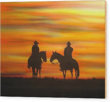 Cowboys At Sunset Wood Print by Chris Fraser