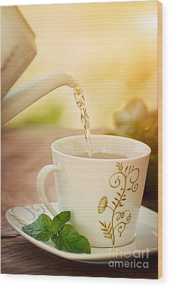 Cup Of Tea Wood Print by Mythja  Photography
