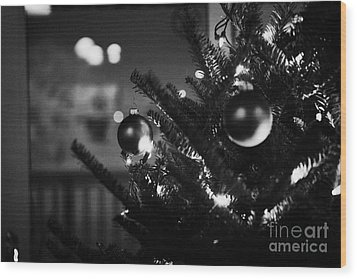 decorated christmas tree looking out of window to snow covered scene in small rural village of Forge Wood Print by Joe Fox